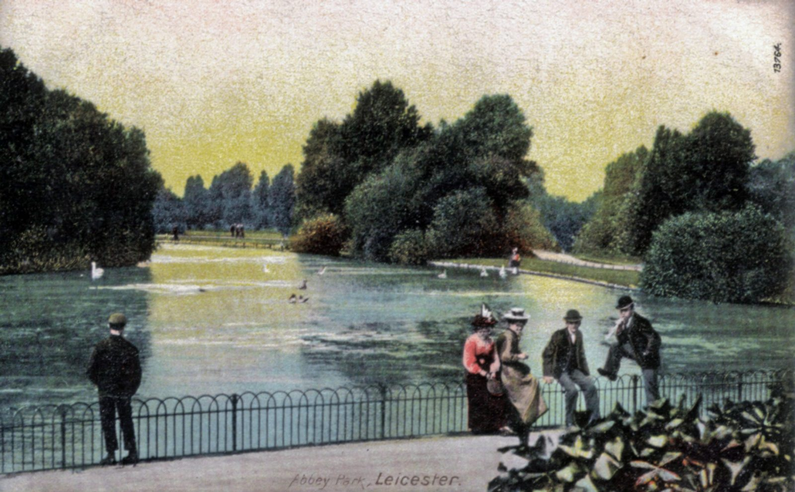 Abbey Park, Leicester. 1901-1920: Young people meeting by the lake in Abbey Park. (File:1005)