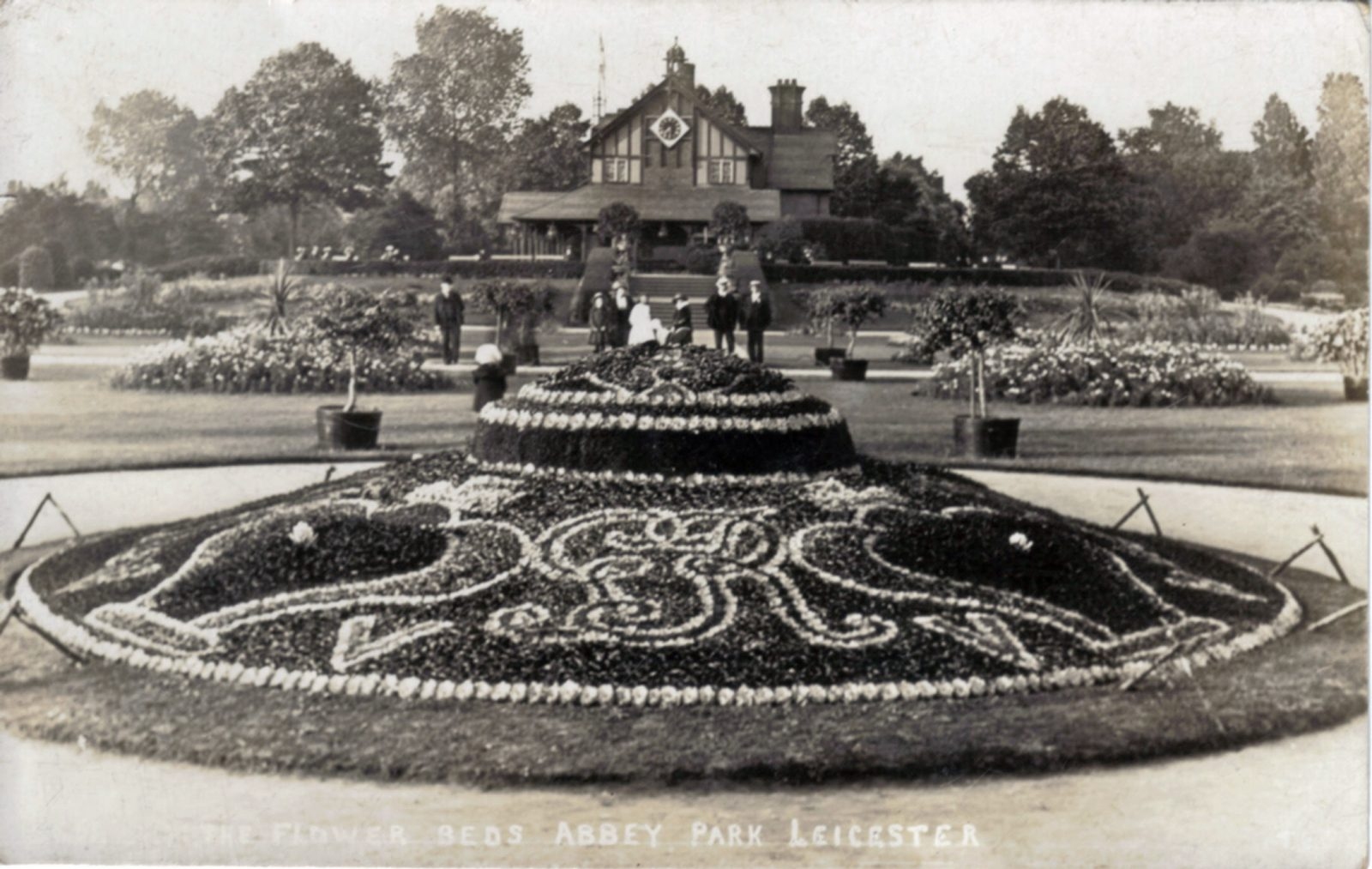 Abbey Park, Leicester. 1901-1920: Pavilion and carpet bedding. People in background (File:1026)