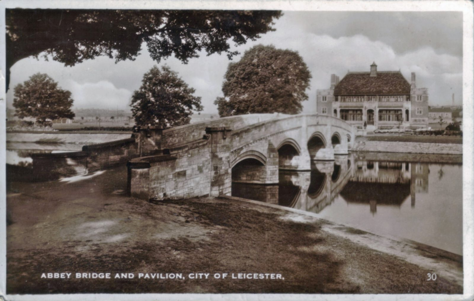 Abbey Park, Leicester. 1921-1940: Abbey bridge, lake and pavilion. Franked 1938 (File:1031)