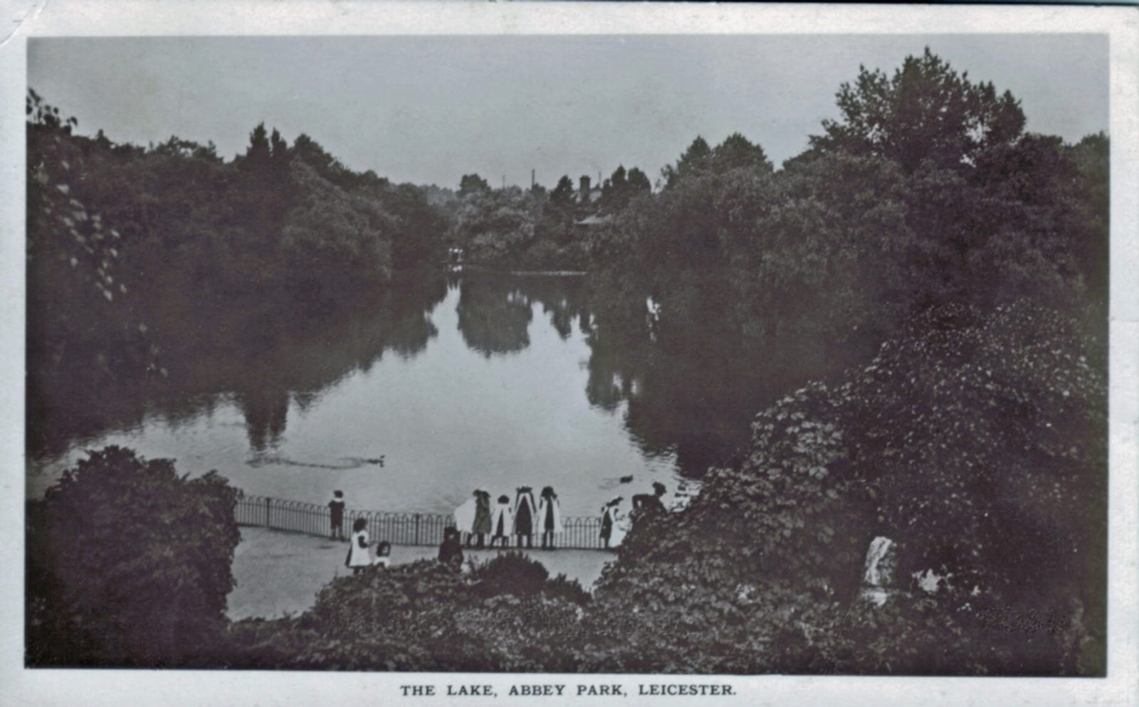 Abbey Park, Leicester. 1901-1920: The lake with children in foreground. Posted 1911-12 (File:1034)