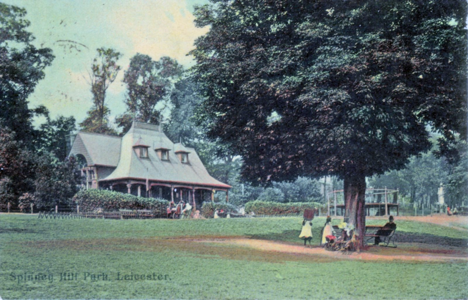 Spinney Hill Park, Leicester. 1901-1920: The Pavilion with children under a tree in the foreground. Franked 1905 (File:1054)