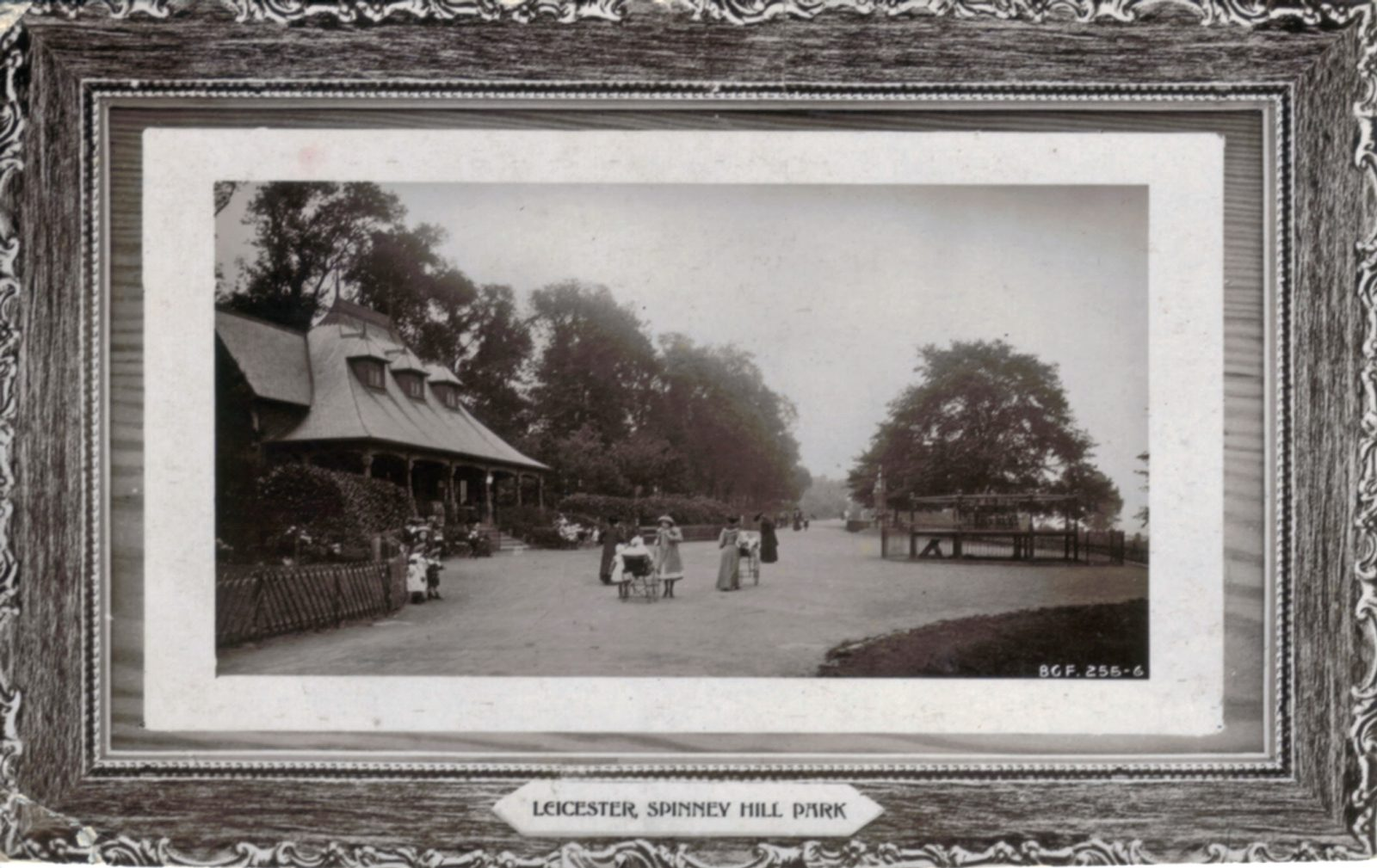Spinney Hill Park, Leicester. 1901-1920: The Pavilion. Adults with prams and children on broad avenue. (File:1058)