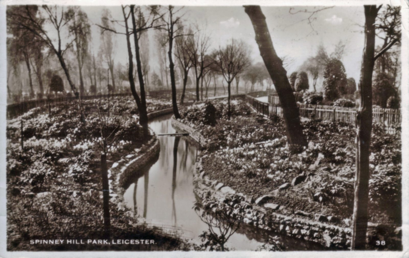 Spinney Hill Park, Leicester. 1921-1940: Stream and informal planting. Franked 1933 (File:1060)
