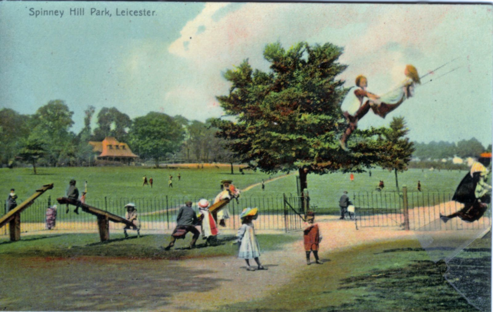Spinney Hill Park, Leicester. 1901-1920: Children's Play Ground with children playing on swings and seesaws. (File:1063)