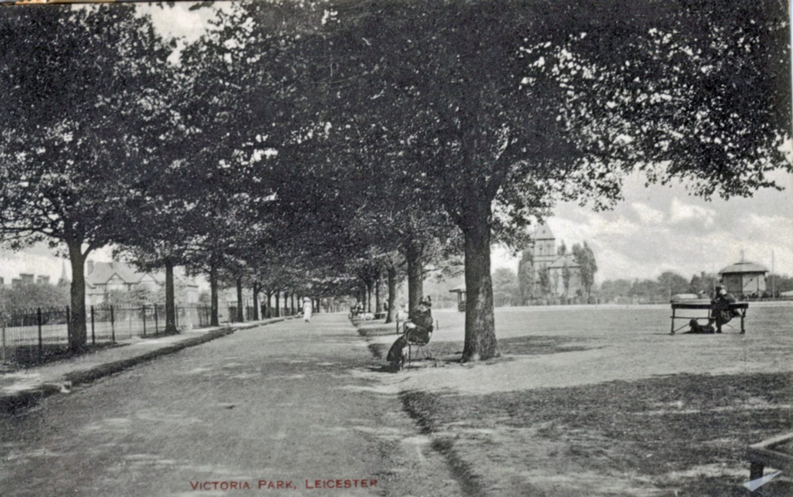 Victoria Park, Leicester. 1901-1920: Broad walk with pavilion in distance. Man on seat. Franked 1915 (File:1076)