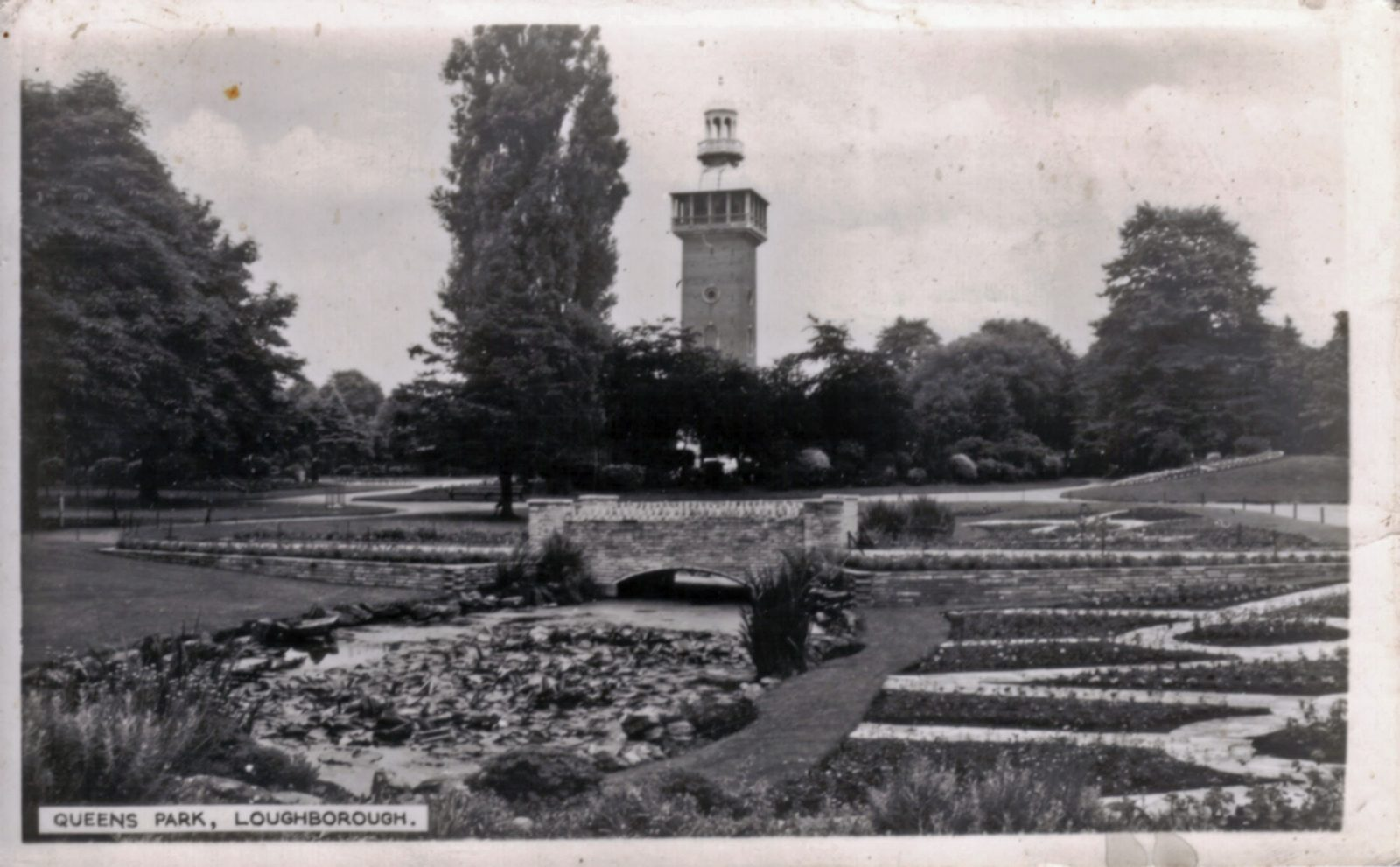 Queens Park, Loughborough. 1941-1960: View across water garden to Carillon Tower. Franked 1954 (File:1134)
