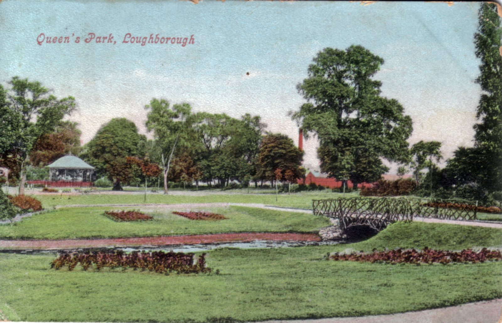 Queens Park, Loughborough. 1901-1920: Looking across a stream with rustic bridge. Formal beds. Bandstand in distance. Franked 1908 (File:1138)