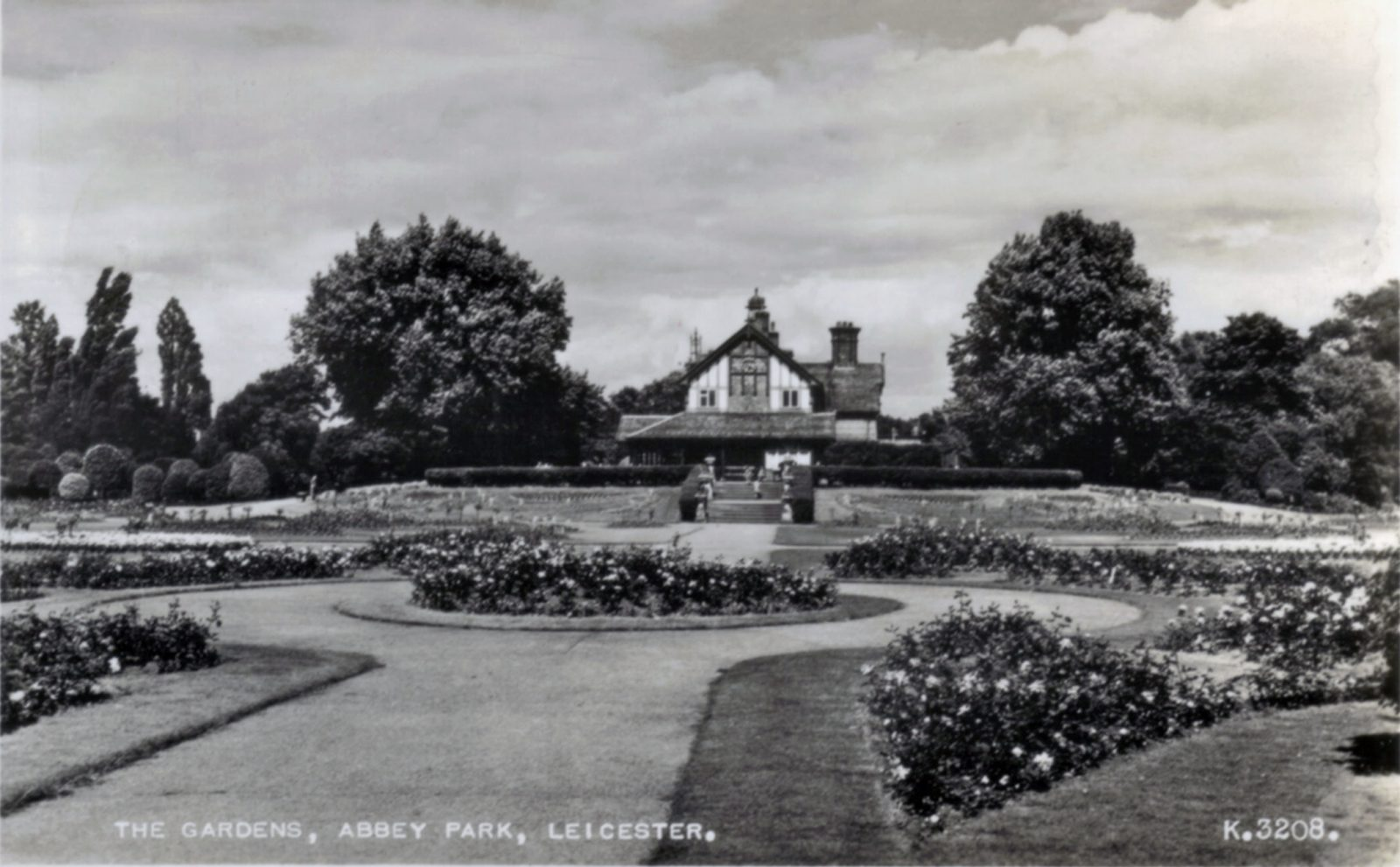 Abbey Park, Leicester. 1941-1960: The Pavilion with formal bedding. Franked 1954 (File:1214)