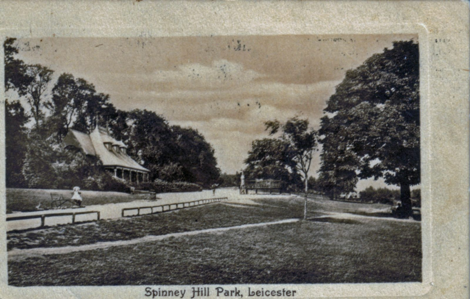 Spinney Hill Park, Leicester. 1901-1920: The Pavilion and avenue with children sitting. Franked 1910 (File:1251)