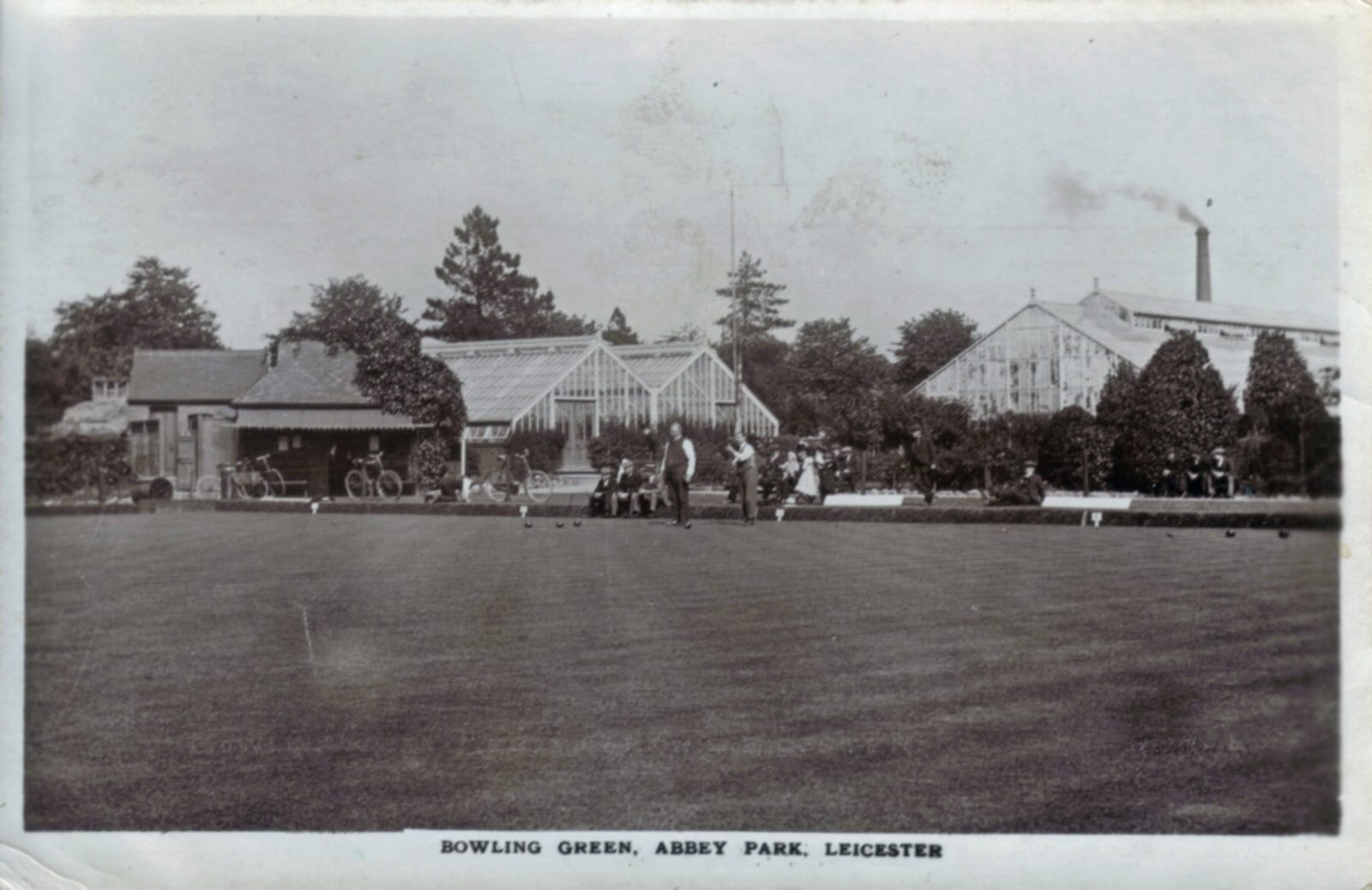 Abbey Park, Leicester. 1921-1940: Bowling green with green houses in the background (File:1431)