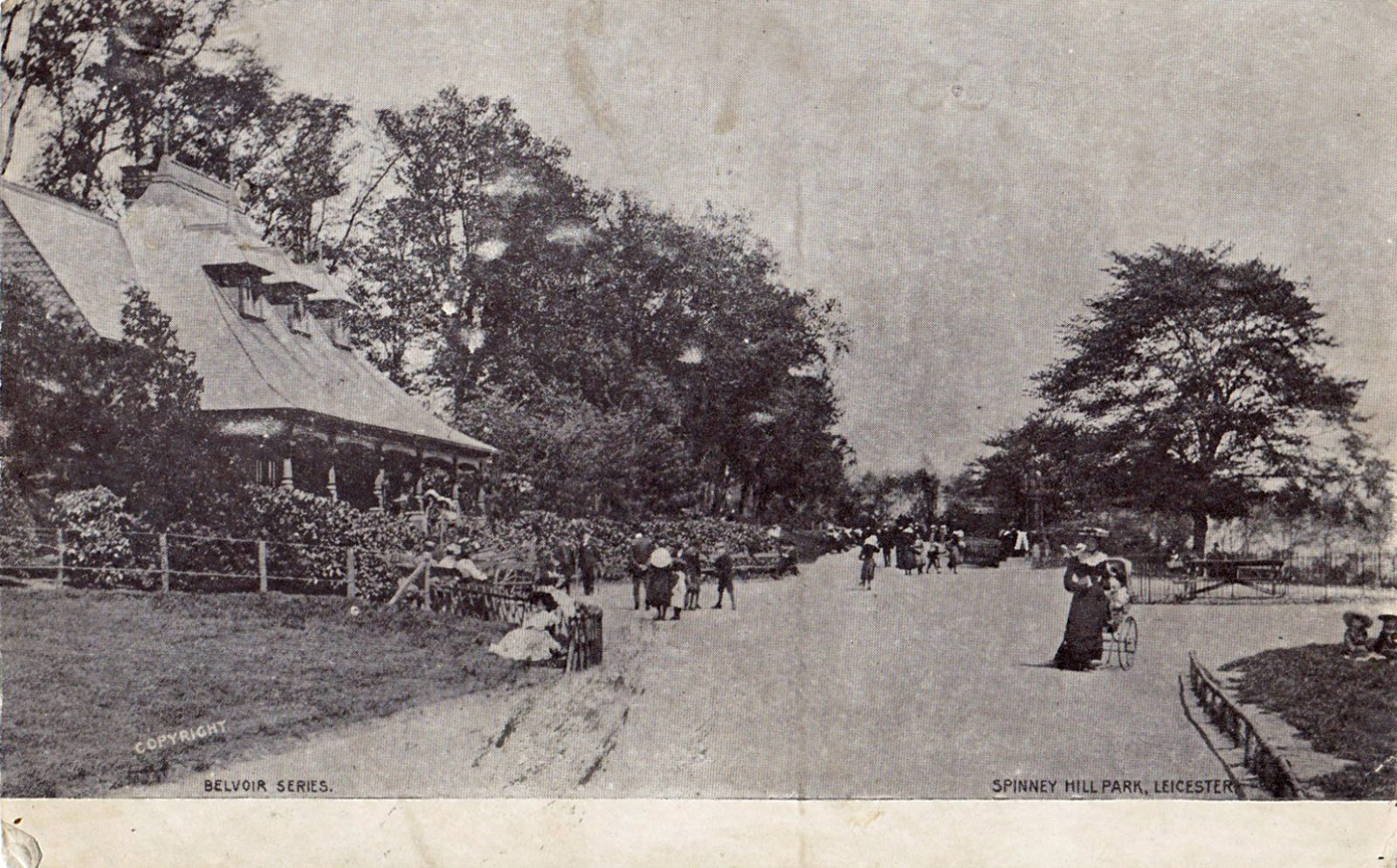 Spinney Hill Park, Leicester. 1901-1920: The Pavilion and broad avenue with people promenading and sitting. Franked 1904 (File:1473)